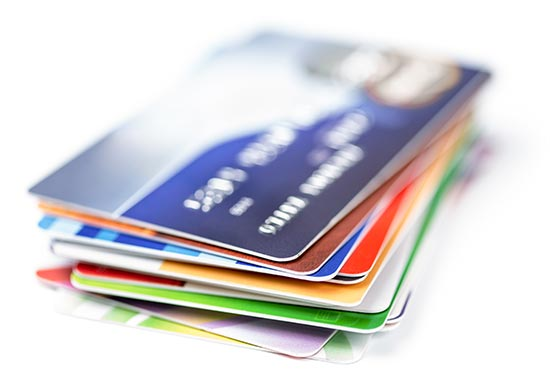 a stack of credit cards - bad debt concept.