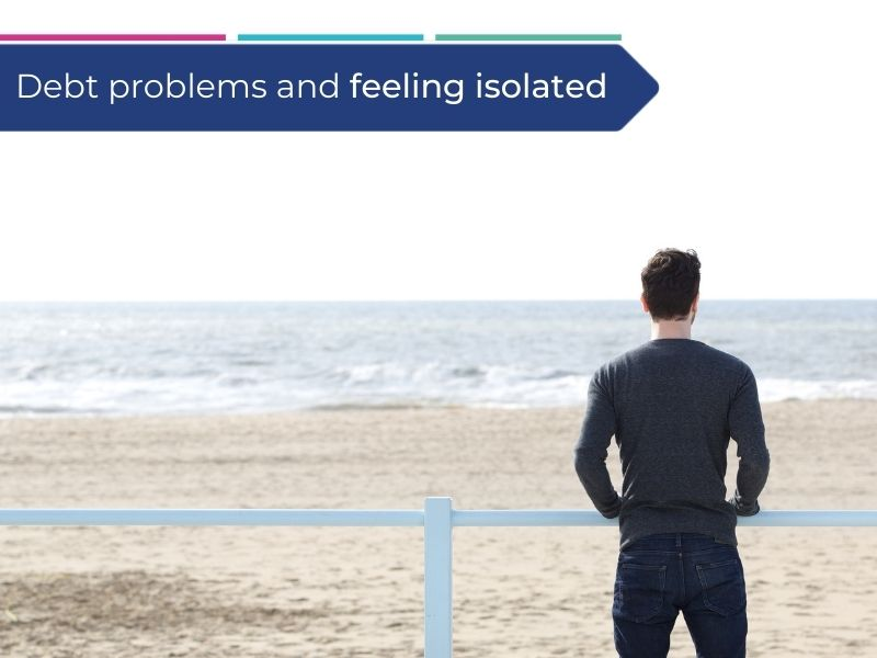 Man standing on the beach feeling isolated and thinking about his debt problems