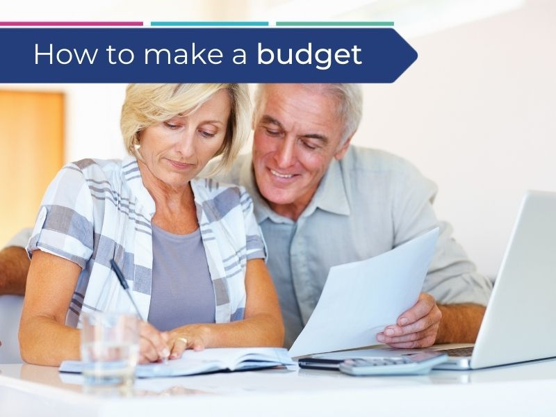 husband and wife creating a budget to deal with short term income changes