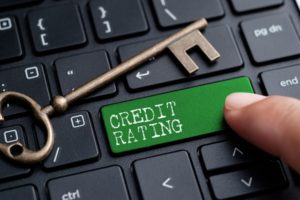 a close up of a finger on a keyboard button that says credit rating