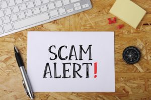 the words scam alert written on a piece of paper - a blog abount getting iva scam savvy