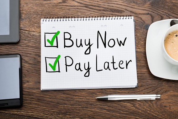 buy now pay later written on a notepad