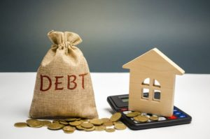a bag of money with the word debt and a wooden house - a blog about debt and divorce