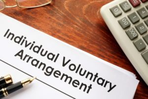 the words individual voluntary agreement on a contract - a blog post about iva early settlement