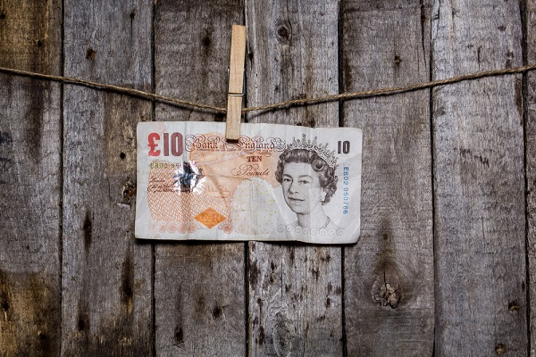 a £10 note on a washing line - money laundering concept