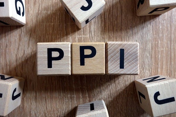PPI word (Payment Protection Insurance) from wooden blocks on desk - a blog about IVAs and PPI