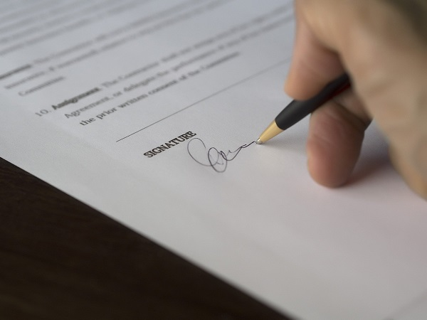 an individual signing agreement document