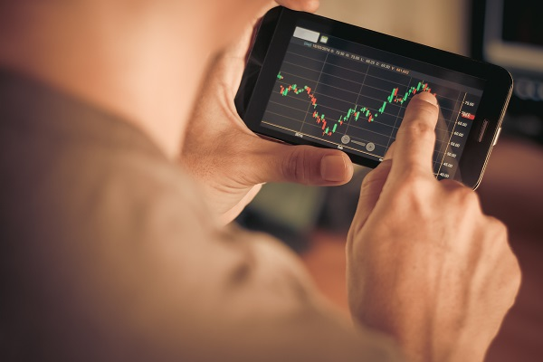 Man checking stocks on a trading app