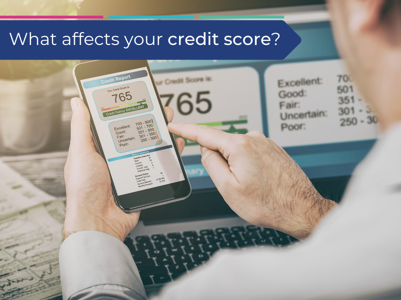 Man checking his credit score on his phone to understand if he needs debt help